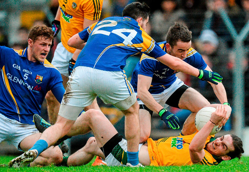 Meath's Cillian O'Sullivan attempts to hold off Longford players (l-r) Shane Doyle, Mark Hughes and Colm P. Smyth in their O'Byrne Cup clash Photo: Piaras Ó Mídheach / Sportsfile