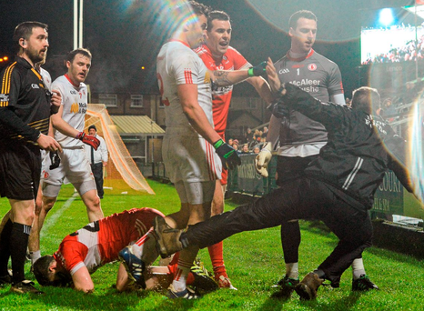 Cathal McCarron pushes Derry manager Damian Barton to the ground in an incident near the end of the game which saw referee Noel Mooney sending them both to the line in the Athletic Grounds Photo: Oliver McVeigh / SPORTSFILE