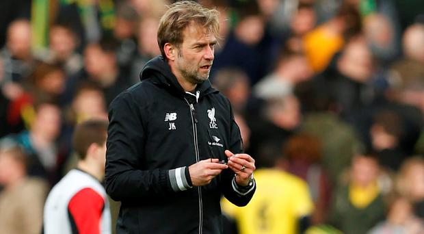 Liverpool manager Juergen Klopp holds his broken glasses at the end of Saturday's match against Norwich City. The FA Cup will add to Liverpool's fixture congestion. Photo: Reuters / John Sibley.