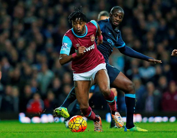 Manchester City's Yaya Toure in action against West Ham's Alex Song at Upton Park. Photo: Reuters / Eddie Keogh.