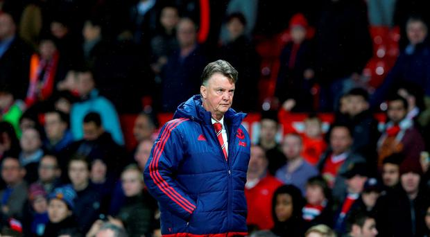 Manchester United manager Louis van Gaal leaves the field dejected
