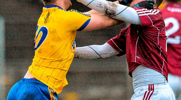Roscommon's Ultan Harney and Galway's Eamon Brannigan, confront each other during the FBD Connacht League final in Tuam Photo: David Maher / SPORTSFILE