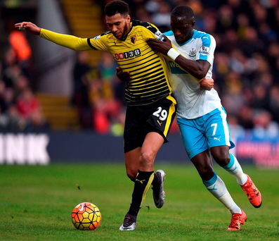Watford's Etienne Capoue (left) and Newcastle United's Moussa Sissoko battle for the ball Photo: Andrew Matthews/PA Wire
