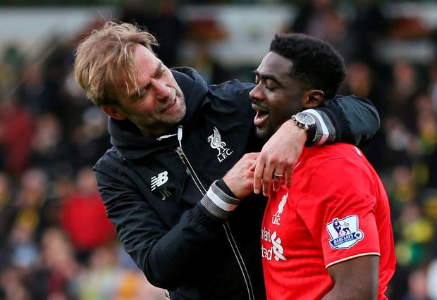 Liverpool manager Juergen Klopp celebrates with Kolo Toure at the end of the match