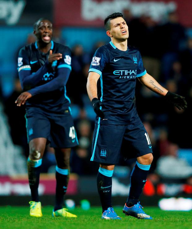 Manchester City's Sergio Aguero and Yaya Toure look dejected at the end of their match against West Ham at Upton Park
