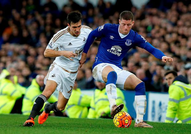 Swansea City's Jack Cork (left) and Everton's Ross Barkley battle for the ball during the Barclays Premier League match at the Goodison Park.