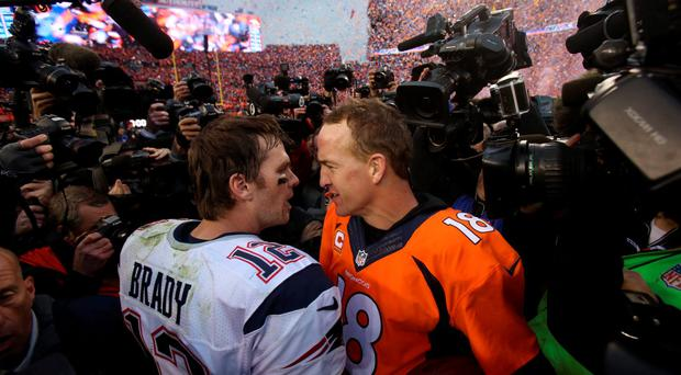 New England Patriots quarterback Tom Brady (12) and Denver Broncos quarterback Peyton Manning (18) talk after the AFC Championship football game at Sports Authority Field at Mile High. Credit: Chris Humphreys-USA TODAY Sports