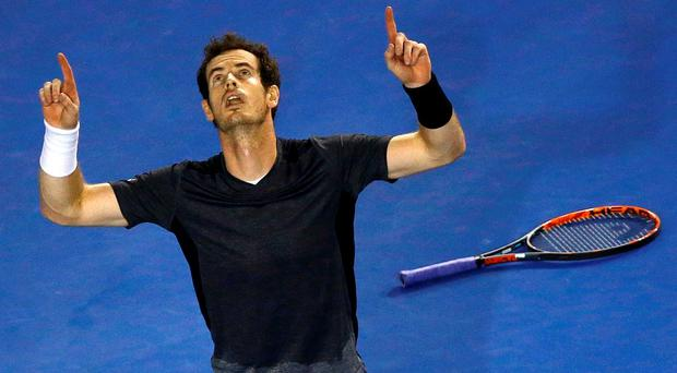 Andy Murray celebrates after winning his fourth round match against Australia's Bernard Tomic at the Australian Open