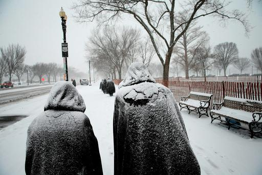 Nuns in Chicago, Illinois covered in newly fallen snow from Storm Jonas Credit: Win McNamee (Getty Images)