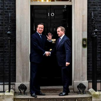 Britain's Prime Minister David Cameron (L) greets Taoiseach Enda Kenny at Number 10 Downing Street in London. REUTERS/Toby Melville