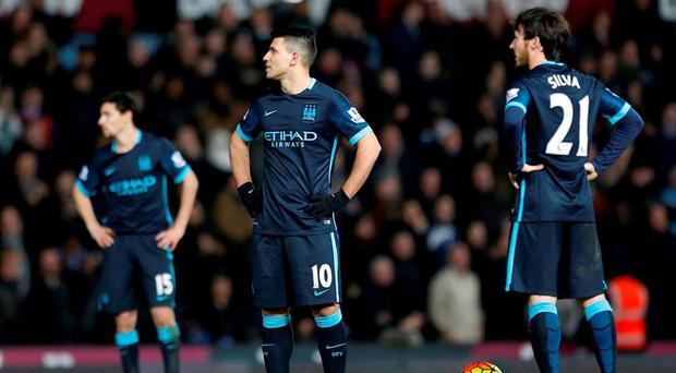 Sergio Aguero and David Silva react during the 2-2 draw with West Ham United at Upton Park