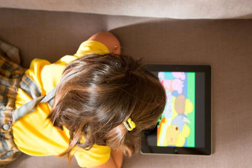 Down time: Kids watch cartoons on digital devices such as tablets, as well as TVs