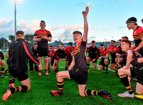 Matthew O'Brien takes centre stage as CBC Monkstown's players celebrate after beating St Gerard's at Donnybrook. Picture credit: Matt Browne / Sportsfile