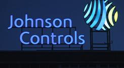 The logo of Johnson Controls stands over its production plant in Hanover, Germany. Photo: Sean Gallup/Getty Images