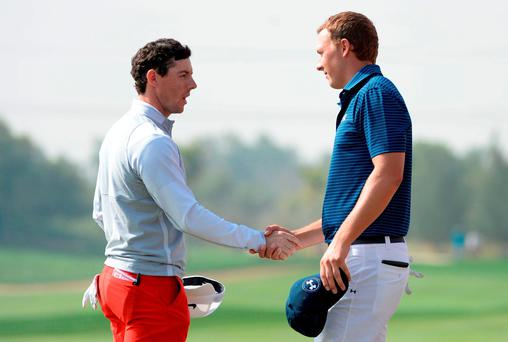 Rory McIlroy shakes hands with world number one Jordan Spieth at the Abu Dhabi Golf Championship