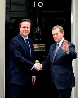 Prime Minister David Cameron (left) greets Taoiseach Enda Kenny outside No 10 Downing Street in London. Photo: Yui Mok/PA Wire