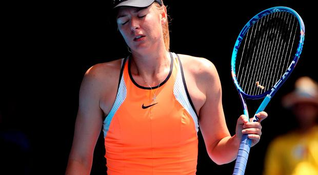 Maria Sharapova of Russia reacts after losing a point to Serena Williams of the United States during their quarterfinal match at the Australian Open tennis championships in Melbourne