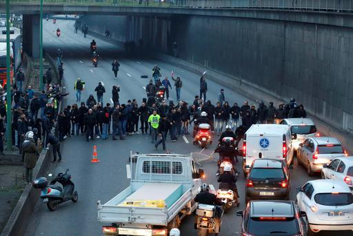 Taxi drivers block the traffic with a fire during a demonstration against the VTC (transport vehicle with chauffeur) on January 26, 2016 on the ringroad (peripherique) at porte Maillot in Paris