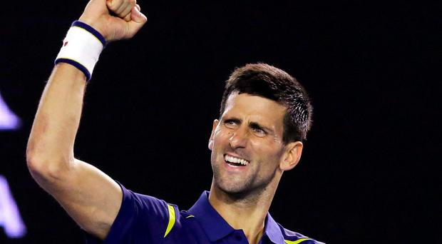 Novak Djokovic celebrates after defeating Kei Nishikori in their quarter-final match at the Australian Open tennis championships in Melbourne
