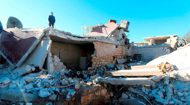A man inspects a site hit by what residents said were airstrikes carried out by the Russian air force in the town of Turmanin, in Idlib Governorate near the Syrian-Turkish border, January 25, 2016