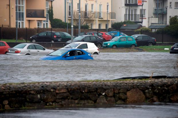 Cars destroyed in Toft car park in the flooding in Salthill as storm Jonas hits the West coast. Photo: Andrew Downes