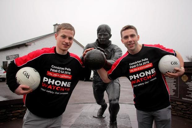Pádraig Óg Ó Sé with his cousin Kerry footballer Marc Ó Sé' posing beside the Páidí Ó Sé statue at Church Cross, Ventry on the Dingle Peninsula ahead of the 27th PhoneWatch Comortas Peile Páidí Ó Sé 2016