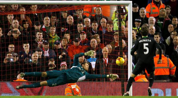 Liverpool's Simon Mignolet saves from Stoke's Marc Muniesa during the penalty shootout