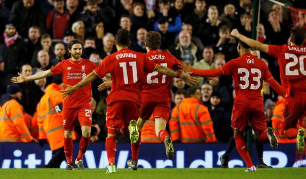 Liverpool's Joe Allen celebrates with team mates after scoring the penalty to win the penalty shootout