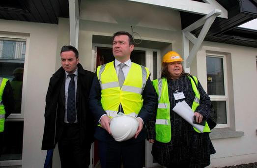 Local Labour TD John Lyons (left), Minister for the Environment, Community & Local Government Alan Kelly, and Tina Donaghy, head of Housing & Devolpment at Fold Ireland at the announcement of details of a new social house building programme. Photo: Collins