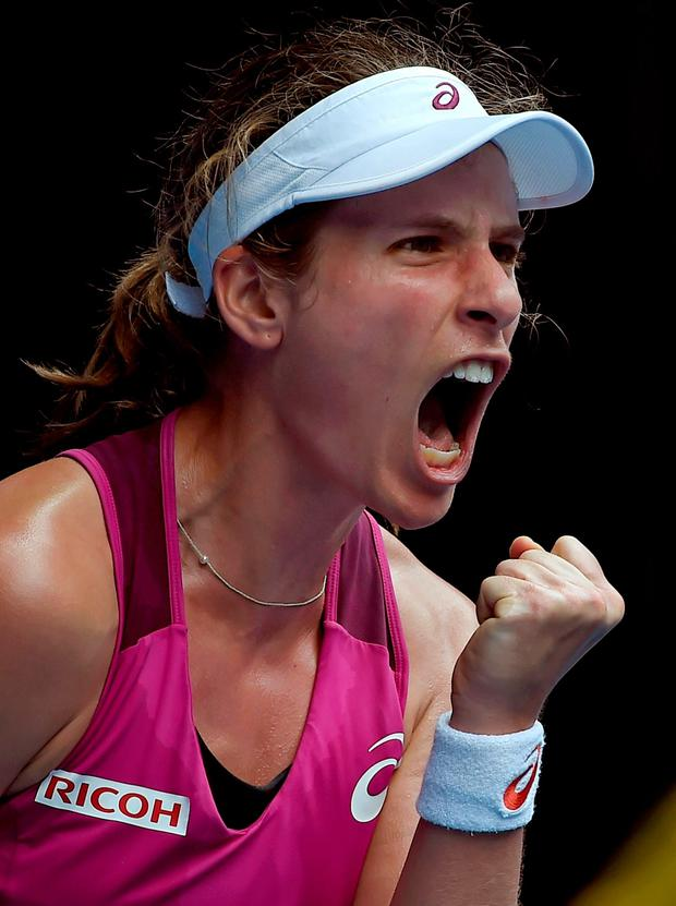 Johanna Konta of Britain celebrates after winning the first set of her quarterfinal match against Zhang Shuai of China at the Australian Open tennis championships in Melbourne
