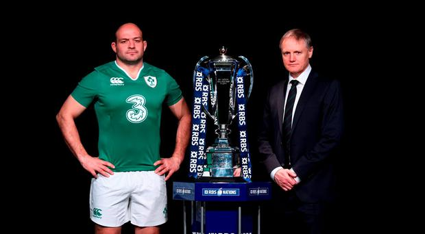 Rory Best, captain of Ireland and head coach Joe Schmidt pose with the trophy during the RBS Six Nations launch at The Hurlingham Club in London, England. (Photo by Stu Forster/Getty Images)