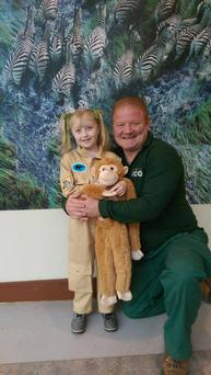 Saoirse Brophy, pictured with Gerry Creighton, donned a zookeeper jumpsuit to spend the day at Dublin Zoo thanks to Make a Wish