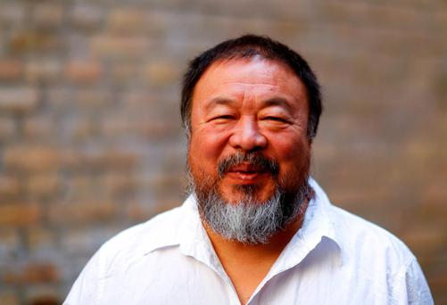 Dissident Chinese artist Ai Weiwei smiles in his atelier in Berlin, Germany, August 13, 2015. Reuters/Pawel Kopczynski/Files