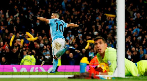 Sergio Aguero celebrates after scoring the third goal for Manchester City as Everton's Joel Robles looks dejected