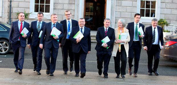 Members of the Oireachtas Banking Inquiry Committee, led by chairman Ciaran Lynch (centre), launch the report at Leinster House yesterday. Photo: Tom Burke