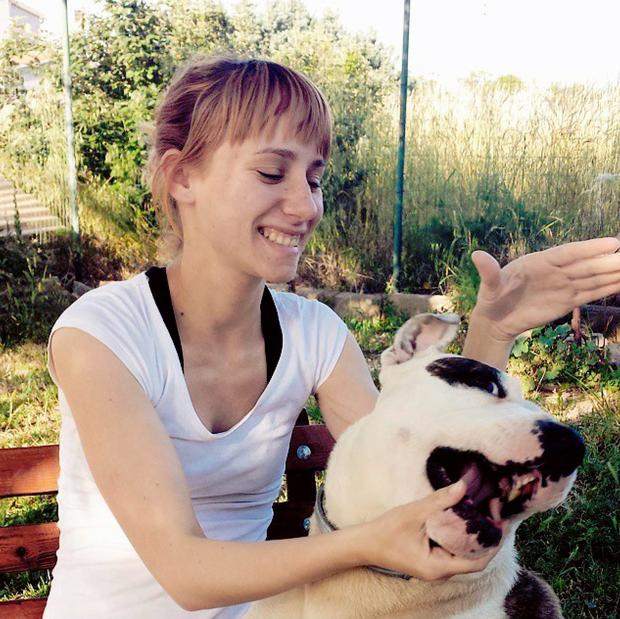 Paola Sahovic with the dog that attacked her