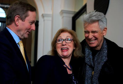 Taoiseach Enda Kenny TD Minister for Education Jan O'Sullivan TD U2's Adam Clayton during an announcement by the Department of Education & Skills to future ongoing funding of Music Generation, IrelandÄôs National Music Education Programme at Government Buildings, Dublin. Photo: gareth chaney Collins
