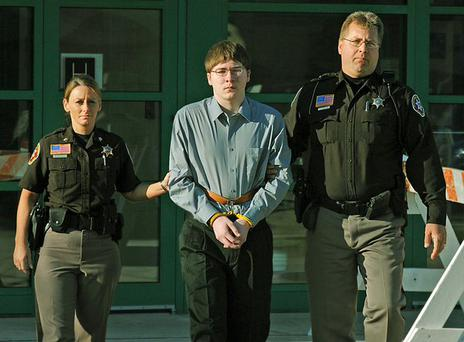Making a Murderer's Brendan Dassey is escorted into court on the day of his trial in March 2006. Photo: Netflix
