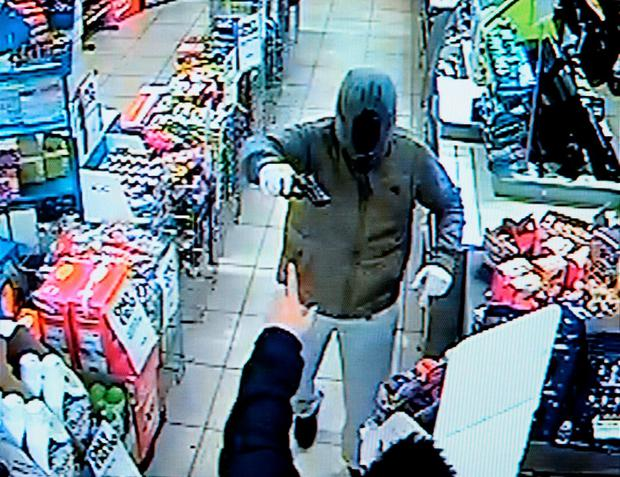 CCTV footage of armed robbery at Centra shop, Corduff, Dublin.