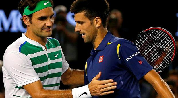 Novak Djokovic and Roger Federer shake hands at the net after Djokovic won their semi-final match at the Australian Open