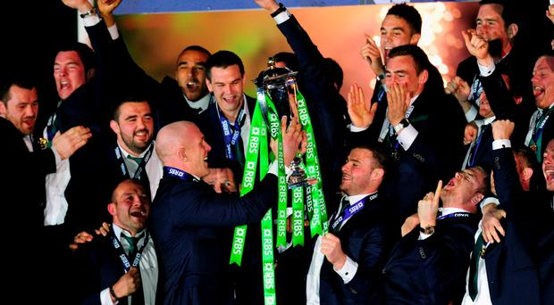 Paul O' Connell offers the trophy to the rest of the team at the end of the 2015 Six Nations campaign