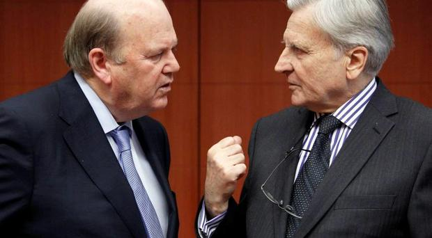 Michael Noonan with Jean-Claude Trichet in Brussels. REUTERS/Thierry Roge