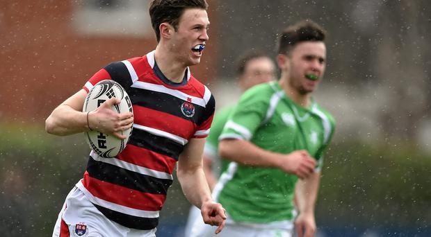 Alistair Quirke, Wesley College, races clear to run in his side's first try of the game (SPORTSFILE)