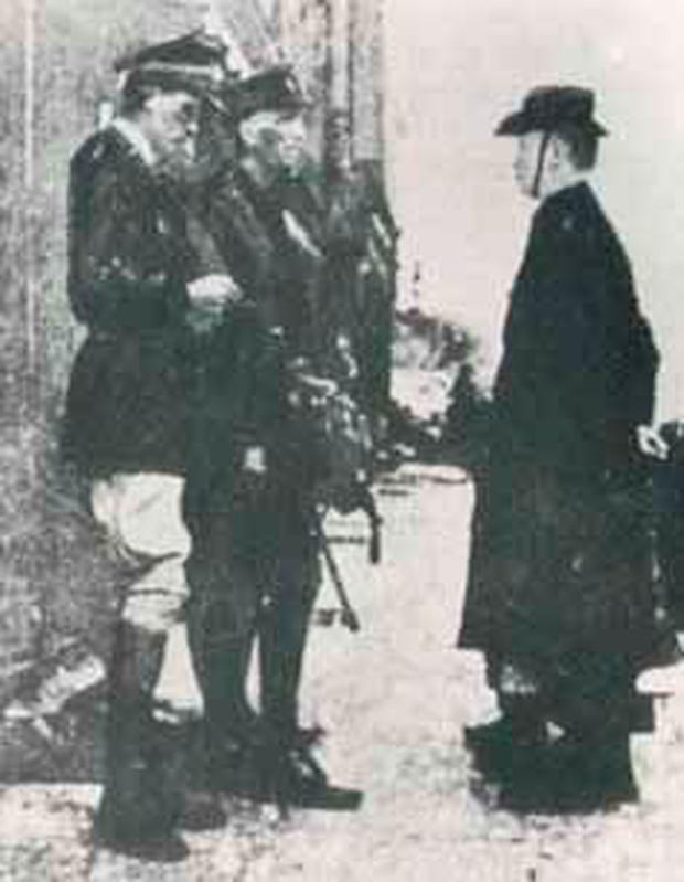 Padraig Pearse (on the right) surrenders to British forces in 1916 to end the Rising