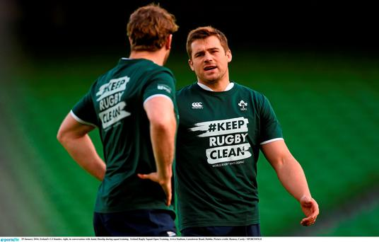 Ireland's CJ Stander, right, in conversation with Jamie Heaslip during squad training