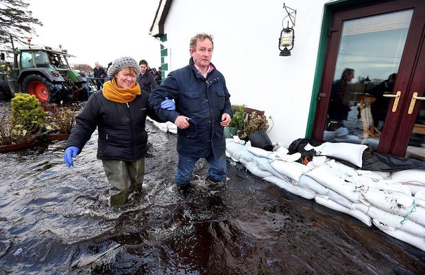 Gertie Dunning from Carrickobrien in Athlone invites Taoiseach Enda Kenny into her flooded home following the recent flood damage to the area. Steve Humphreys Irish Independent