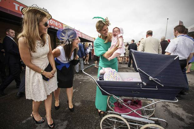 34. MY LITTLE BONNIE Mairead Murphy, from Sligo, shows off her 4-month-old baby, Pearl, to Rachel Williams and Ruth Walsh on Ladies Day at the Galway Races - Mark Condren, Irish Independent, Press Photographers Association of Ireland 'Press Photographer of the Year' 2016