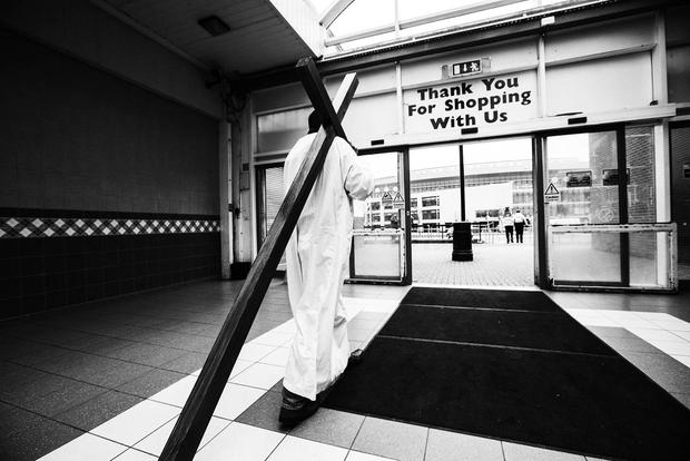 21. CARRYING THE CROSS A re-enactment of the Stations of the Cross on Good Friday, at Ballymun Town Centre - Mark Condren, Irish Independent, Press Photographers Association of Ireland 'Press Photographer of the Year' 2016