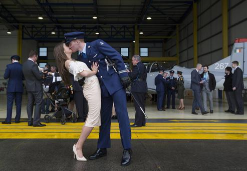Sealed with a kiss : Lieutenant Kevin Fitzgerald gives his partner Emma Day a kiss after he was awarded his Wings at a ceremony at Casement Aerodrome. Photo: Mark Condren