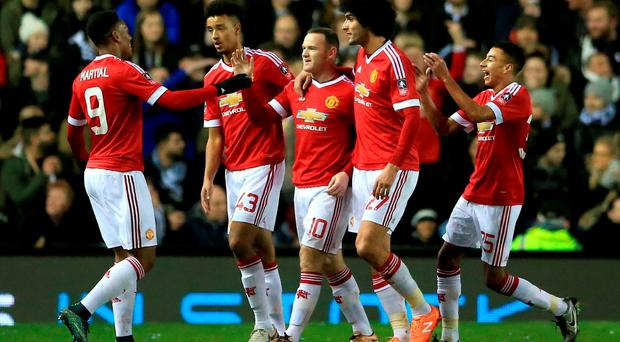 Manchester United's Wayne Rooney (centre) celebrates scoring his side's first goal of the game alongside teammates during the Emirates FA Cup, fourth round match at the iPro Stadium, Derby